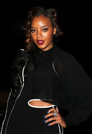 Angela Simmons wore a vibrant blue shade of nail polish at the Diesel Black Gold fall 2012 fashion show.