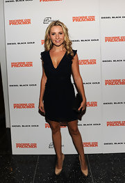 Beverly Mitchell carried a simple leather clutch at the 'Machine Gun Preacher' premiere.