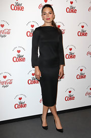 Melia Kreiling opted for a modern look with this sleek black satin dress.