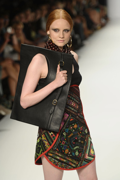 Barbara Meier modeled a black leather tote during the Dimitri Show at Berlin's Fashion Week.