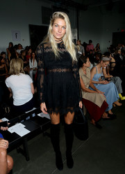 Jessica Hart was bohemian-chic in a black lace mini dress while attending the Dion Lee fashion show.