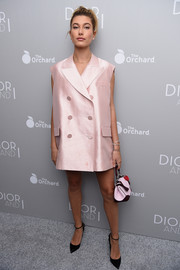 Hailey Baldwin rocked an oversized pink silk vest at the 'Dior and I' premiere.