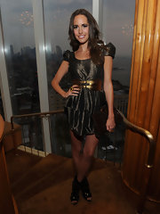 Louise Roe paired her metallic dress with an oversized clutch.