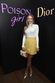 Harley Viera-Newton was '60s-chic in her yellow mini skirt and white turtleneck combo.