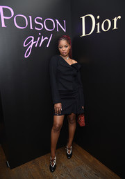 Keke Palmer went understated in an asymmetrical black skirt suit by Dior at the NY Poison Club event.