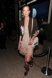 Karlie Kloss accessorized with a stylish white leather bag when she attended Dior's Fashion's Night Out party.