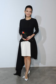 Looking elegant as ever, Zhang Ziyi chose a black and white high-low dress with a white peek-a-boo skirt.