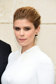 Kate Mara styled her hair into a poofy bun for the Dior Homme fashion show.