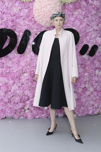 Gwendoline Christie layered a baby-pink coat over a little black dress for the Dior Homme Spring 2019 show.