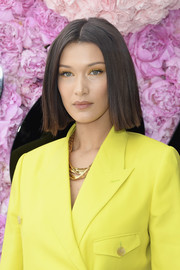 Bella Hadid showed off a sleek center-parted bob at the Dior Homme Spring 2019 show.