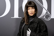 Bella Hadid styled her outfit with a silver chain necklace by Dior.