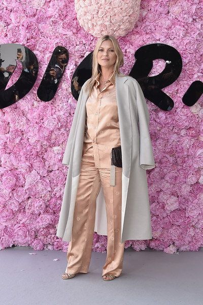 Kate Moss finished off her outfit with a pearl-gray coat.