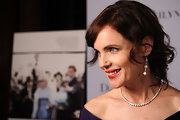 Elizabeth McGovern piled on the elegance at the New York Film Festival, wearing dangling diamond earrings and a tennis necklace with her beautiful dress.