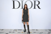 Alexa Chung attended the Dior Fall 2020 show wearing a gray vest dress from the label.