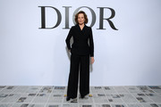 Sigourney Weaver kept it low-key in a black pantsuit at the Dior Fall 2020 show.