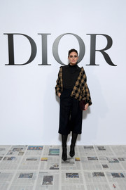 Olivia Palermo rocked mixed prints with this checkered jacket and dotted blouse combo at the Dior Fall 2020 show.