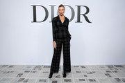 Karlie Kloss was office-chic in a checkered pantsuit at the Dior Fall 2020 show.