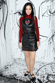 Leigh Lezark looked oh-so-cute in a black leather pinafore dress by Dior during the brand's Spring 2018 collection launch.