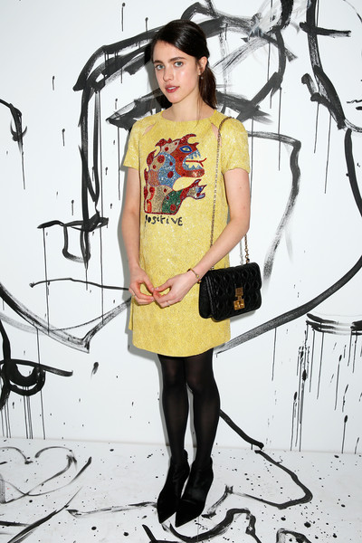 Margaret Qualley accessorized with a classic quilted leather bag by Dior.