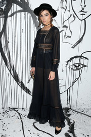 Olivia Culpo went for a boho-meets-sexy vibe with this sheer black maxi dress by Dior during the brand's Spring 2018 collection launch.