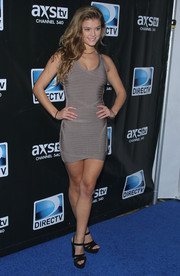 Nina Agdal turned heads in a taupe bandage dress during the DirecTV Super Saturday Night.