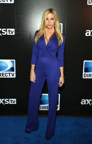 Camille Grammer donned a cobalt jumpsuit with a plunging neckline and a twisted bodice for the DirecTV Super Saturday Night.