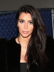 Kim Kardashian arrived for the DirecTV Super Saturday Night wearing her long locks swept to the side.