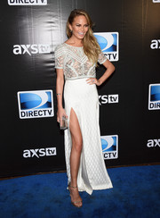 Chrissy Teigen was trendy-glam in an embellished crop-top by Temperley London during the DirecTV Super Saturday Night.