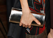 Thandie Newton opted for a simple silver clutch to pair with her colorful beaded frock.