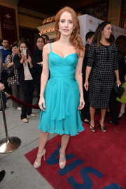 Jessica Chastain cut an ultra-feminine silhouette in a turquoise cocktail dress with a flirty hem during the premiere of 'The Disappearance of Eleanor Rigby.'