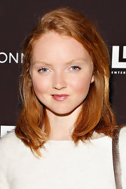 Lily Cole chose a shiny pink lip to add a touch of color to her pout.