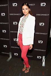 Olivia Culpo chose a crisp white blazer to pair over her patterned blouse.