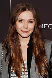 Take a page from Elizabeth Olsen's beauty book: a simple pink lip gloss can go a long way!