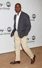 Taye showed off her casual side in a grey blazer and khaki pants.