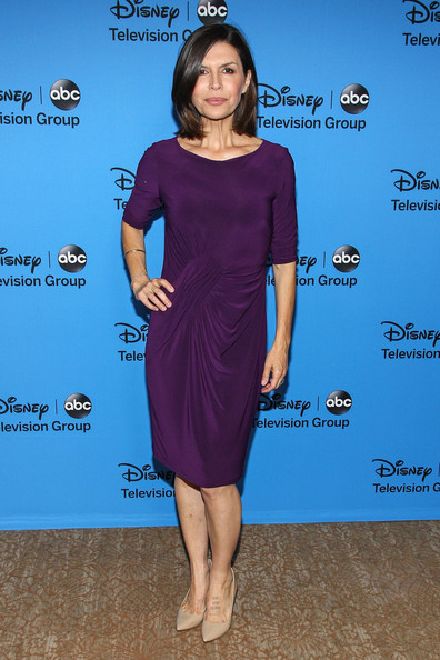 Finola Hughes' deep plum dress featured elegant draping that added a more sophisticated touch to her look.