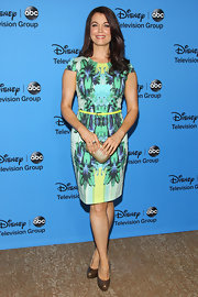 Bellamy went tropical cool with this island-chic printed sheath dress.