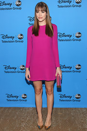 Christa goes pretty in pink in this long-sleeve mod-inspired mini dress.