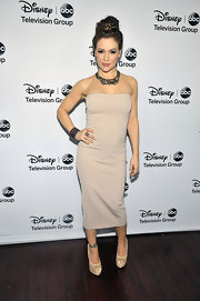 Alyssa was smoking at the Disney fete in this tight shin-length nude tube dress!