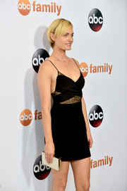Amber Valletta paired an ultra-glam crystal-studded box clutch with a sexy LBD for the Disney Group's Summer TCA Press Tour.