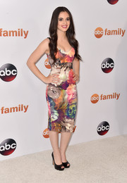 Vanessa Marano cut an ultra-feminine figure in this multicolored floral frock during the Disney Group's Summer TCA Press Tour.