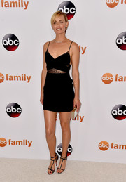 Amber Valletta kept the sultry vibe going all the way down to her black Louboutin T-strap heels.