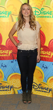 Bridgit Mendler's black hip-hugging jeans provided a nice contrast to her demure top.