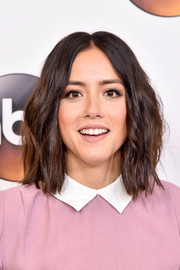 Chloe Bennet wore subtle waves with a center part at the Disney ABC Summer TCA Tour.