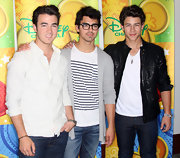The boys are known for their cute curls. Nick sported the longest look but kept it soft and polished.