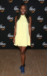 Aja Naomi King contrasted her girly dress with edgy blue peep-toe booties.
