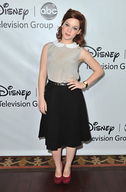 Jane Levy accessorized with burgundy platform pumps.
