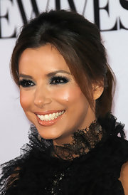 Eva Longoria paired her dramatic smoky eyes with a super shiny nude lipstick at the 'Desperate Housewives' final season kick-off party.