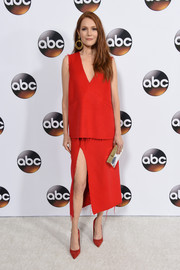 Darby Stanchfield attended the Disney ABC Television Group Winter TCA Tour wearing a sleeveless, V-neck red top by Vivian Chan.
