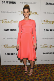 Ashley Greene brought a lovely pop of color to the 'Jungle Book' screening with this bright coral fit-and-flare frock by Novis.