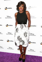 Viola Davis attended the Disney Upfronts wearing a Carmen Marc Valvo monochrome dress featuring a tight-fitting top and a floral skirt.